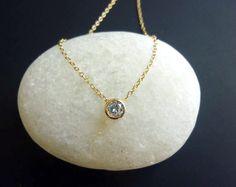 tiny diamond look necklace in gold-bezel set solitaire diamond look necklace-diamond cz solitaire necklace in gold-small diamond necklace. $32.00, via Etsy.