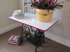 Enameled top table with sewing machine iron base.. $195.