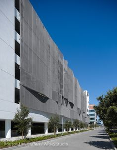 Mission Bay Block 27 Parking Structure / WRNS Studio. The north and east façades, which face public open space, are clad in perforated aluminum panels with pixelated imagery of California's redwood forests. This imagery is intended to evoke the filigree of adjacent tree canopies and create a sense of pedestrian scale.