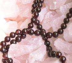 Garnet Round beads on Rose Quartz background Gems Jewelry, Beaded Jewelry, Beaded Necklace, Gem S, Round Beads, Crystal Healing, Gemstone Beads, Rose Quartz, Garnet