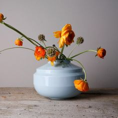 This light blue wide edged vase is made of glazed porcelain with powerfull lines and sharp edges. The vase is part of a series of three vases. 'Wide Edged' is the thickest. Then there is 'High Edged' and 'Low Edged' two matching vases with different shapes and sizes. They are available in white, light blue and turquoise.