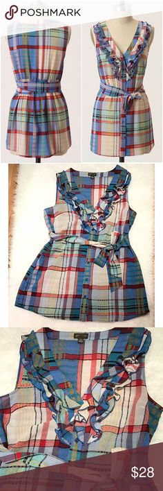 """EUC Anthro Fei Caricaturist Plaid a Ruffles Tunic Gently used and in excellent condition Anthro Tunic Blouse in size 8. Stretchy mastic back with Ruffles and belt details. No flaws. Measure about 29"""" length, 12"""" waist, 15"""" pit to pit. ❌No modeling or trades. Open to reasonable offers. 15% OFF BUNDLING DEALS. Thank you‼ Anthropologie Tops Tunics"""