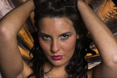 Adriana Lopez - photovision. Using Parabolic Umbrella lit with a tungsten lamp as a background
