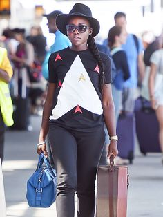 Lupita Nyong'o arrived in the Big Apple looking trendier than ever in a floppy fedora 'n' matte navy sunnies!