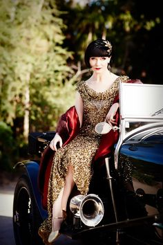 Miss Fisher is a modern woman who drives fast. Roaring Twenties Costume Design   Miss Fisher Murder Mysteries costume designer Marion Boyce Australian Broadcasting
