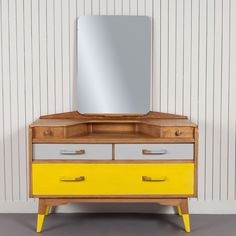Eaton - £450.00 - This timeless piece of 1950s design has been partnered with yellow and grey dip painted handles and feet to enhance its classic retro look. The bold additions to this already iconic G-plan dresser ensure that it will remain a statement piece for many years to come. Product specification:W 147 x D 46 x H 114 cm30kgMade by Steve