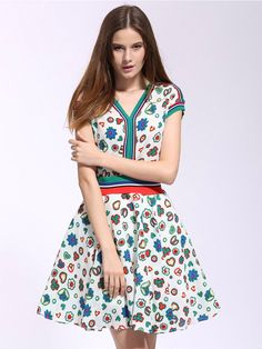 Cute white V-neck floral contrast, short sleeve skater dress for girls this summer.