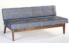 bungy sofa with yellow elastic cord by leala dymond