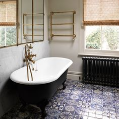 This Victorian house in east London was a typical Eighties conversion, redesigned by Adam Bray to be comfortable and relaxing. The Twenties triptych mirror is gilt metal by Brot, Paris. Moroccan bathroom floor tiles from Habibi Interiors are deliberately mismatched for a patchwork effect. With classic brass faucet and accents.