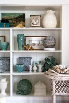 shelf decor.. love the pop of color... my choice would be green