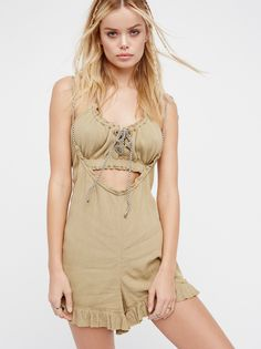 Just A Little Romper Set | Ultra cool and effortless, this set made from our sheer and gauzy Endless Summer fabric features a crop top and a relaxed romper.  * Top features an elastic band under the bust with adjustable ties at the neckline   * Romper features adjustable ties with a scrunched design and a sweet ruffled hem   * Unfinished edges create a lived-in look