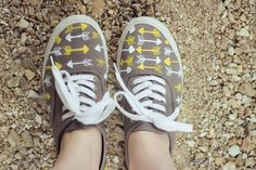 Make a pair of DIY Customized Sneakers by painting arrows along the top.