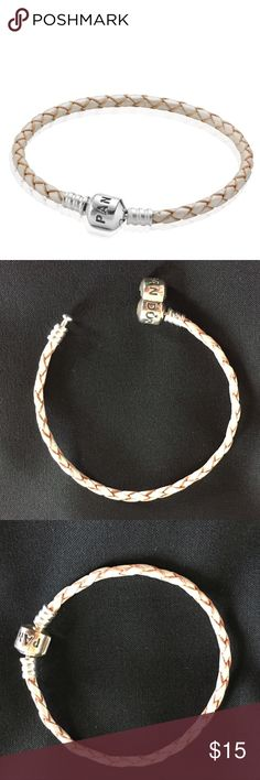 "NWOT PANDORA WOVEN LEATHER BRACELET - PEARL Never been worn/used, single rope bracelet that measures 6"" long, plus clasp. The rope is a pearl champagne color. Bundle 2 or more items for 20% off ❤️❤️ Pandora Jewelry Bracelets"