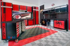 Porsche Themed Garage With Work Bench And Storage Cabinets
