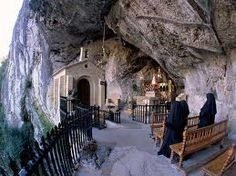small church built in side of mountain in covadonga, spain