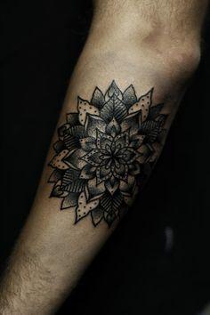 Black dot-work mandala tattoo inked on the left forearm Mandala Tattoo Design, Tattoo Designs, Tattoo Ideas, Dot Work Mandala, Flower Mandala, Future Tattoos, New Tattoos, Traditional Mandala Tattoo, Geometric Flower