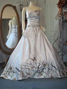 Shown in True Timber Snowfall Pattern and White Satin. Gown shown with crinoline #106 under it.