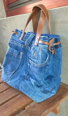 Be original with our adorable jeans bag. It can be great for any occasions. DENIM bag with cotton lining and pocket inside - unique look! This beautiful denim bag is handmade from recycled high quality blue jeans with leather handles. Made out of a pair of jeans! One pocket
