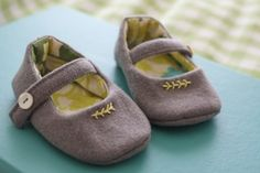 Homemade baby shoes see @ http://probablyactually.wordpress.com/2011/08/08/and-shoes-to-match/
