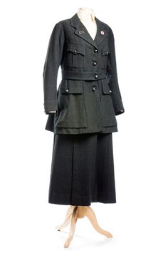 """Red Cross Uniform: ca. 1914-1918. """"Charleston artist, Anna Heyward Taylor (1879-1956), was one of the first South Carolina women to serve in the Red Cross during the war. She was in France for 18 months and this was her uniform."""""""