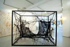 Dutch designer Tord Bootje presents a collection of work made with lace-making techniques from materials including grass and raffia at the Marsden Woo Gallery in London. - looks like a gorgeous black spider web Land Art, Textiles, Tord Boontje, Galleries In London, Art Textile, T Art, Dutch Artists, Angels And Demons, Oeuvre D'art