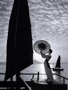 Photographed by Gleb Derujinsky on a junk in Hong Kong harbor, Harper's Bazaar, 1958.
