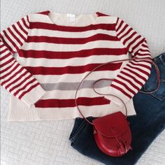 """Host Pick 11/08/15Red & Tan Striped Sweater Super Cute Little Scoop Neck Sweater with a Fun Pop of Color! Wide Red and Tan Stripes across front with one Gray Stripe near hemline adds a little """"Unexpected Punch""""! The full length Sleeves have a narrower Stripe pattern. The back of sweater is Solid Tan. So Cute with your favorite Jeans or shorts! Lighter weight 100% Acrylic. Hand wash, dry flat. Gently used and in excellent condition. No stains or snags. HOST PICK Autumn Essentials…"""