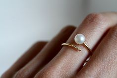 Stunning minimalist 14K Yellow Gold Pearl and Diamond cuff ring features one 5.5mm Pearl on one end with three 1mm White Diamonds adorning the other. Handcrafted in San Diego.