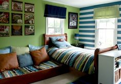We love the striped accent wall in this bedroom!  We can imagine these stripes in so various paint colors. www.FirefliesandFiddlesticks.com