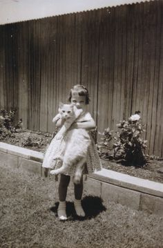 43 Vintage Photographs That Prove Cats Are A Girl's Best Friend