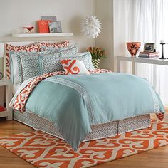 The eye catching Jill Rosenwald Newport Gate Reversible Duvet Cover brings a mix of whimsical designs and vibrant hues to your bed. The slate blue bedding features white embroidered panels, blue swirled prints, and a touch of orange for a lively look. Orange Bedding, Bedroom Orange, Blue Bedding, Bedroom Turquoise, Newport, Inspiration Design, My New Room, Bedding Collections, Dream Bedroom