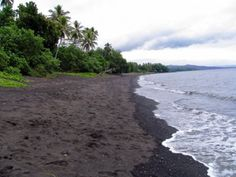 """Black Beach on Ambrym Island, Vanuatu.  Ambrym is known as the """"black island"""" of the Vanuatu archipelago because of its volcanic activity and a tradition of black magic."""