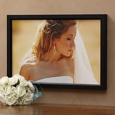 Save HUNDREDS of dollars on your wedding photos! Instead of paying the photographer's high prices, just upload the digital copy of your favorite photos and turn them into beautiful canvases in all different sizes for an unbelievable price from this store!