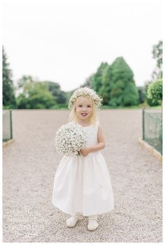 How cute is this little Flower Girl at Middleton Lodge with her Gypsophila floral circlet & posy created by us at www.weddingandevents.co.uk image from Sarah Jane Ethan Photography