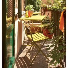 Looking for idea to make our small balcony a pleasant place to sit on in the spring/summer!