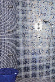 Mosaic walls decorate the lavish baths of the luxurious private bathrooms of the Front Pool Suites of the La Residence 5 Star Luxury Hotel Suites in Mykonos island in Greece.