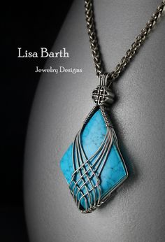 This design was originally inspired by the straps on my sandal.  The stone is a turquoise cabochon and it is wrapped in sterling silver wire.  --Lisa Barth