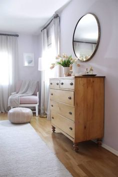Stylish home decor - soft greys and blush hues with wooden furniture