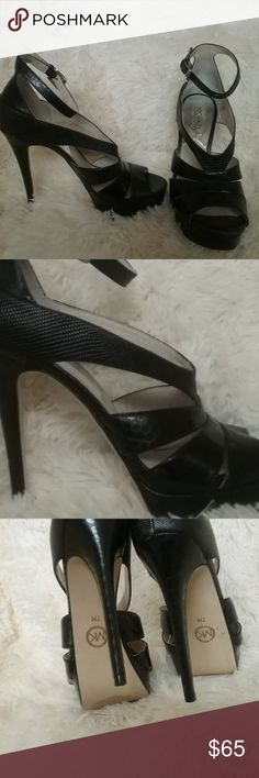 MICHAEL KORS Sexy Black Leather Heels 7 Only worn once indoors for a few hours, if that. A bit too big for me :(. Absolutely gorgeous. Size 7. Each shoe has a tiny white spot on the back from being stored but perfect condition otherwise. Michael Kors Shoes Heels