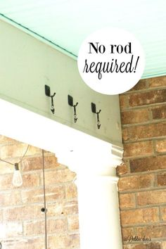 LOVE this trick for How to hang drop cloth curtains on a front porch!