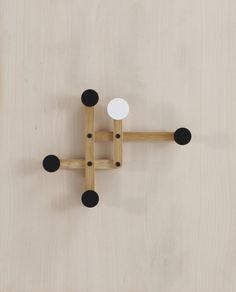 Pauli  is a playful wall- rack, that changes shapes depending on weight