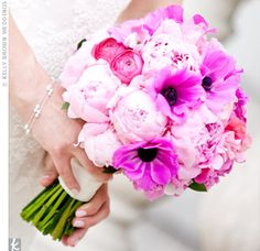 The bride's pink bouquet was made up of a mix of peonies, anemones, sweet pea and ranunculus for texture.