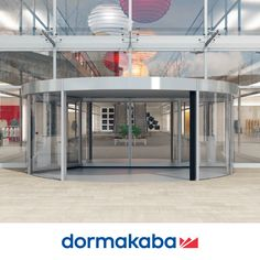 KTC 2 HIGH VOLUME REVOLVING DOOR SYSTEM The optional integrated sliding doors allow for both winter and summer use giving optimum performance all year round. Wherever central entrances of buildings have to handle heavy traffic volumes, where ease of use is paramount and where architecturally refined facades require an equally attractive complement, the dormakaba KTC-Comfortline range of revolving doors provides the perfect answer. Revolving Door, Hotel Architecture, Facades, Sliding Doors, Entrance, Buildings, Handle, Winter, Summer