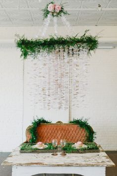 DIY Intricate Paper Punch Chandelier - styling by Ruie & Grace - photo Valerie Demo  http://ruffledblog.com/diy-intricate-paper-punch-chandelier/