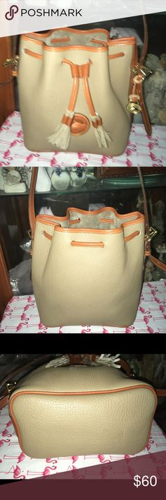 Vintage Dooney and Bourke Drawstring Bag Here is a Vintage Dooney & Bourke Drawstring Bag. It is in great condition there is no wear on this bag. It is 11 inches wide and 9 inches tall Dooney & Bourke Bags Shoulder Bags