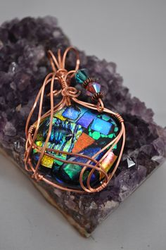 WireWrapped Dichroic Glass Pendant by Colour2Die4 on Etsy https://www.etsy.com/listing/120106409/wirewrapped-dichroic-glass-pendant