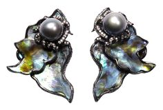 Exotic colors emanate from the mother-of-pearl nacre of abalone. These sea reef and rock creatures build the shells as they grow, with rings of colors gray, blue, green, pink and gold. This earring has assortment of handcrafted jewelry incorporating parts of these shell in various settings. 18K gold, sterling silver black rhodium, diamonds and gray baroque pearls are used to complete the design.