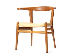 the Bullhorn chair by Hans J. Wegner | From a unique collection of antique and modern dining room chairs at https://www.1stdibs.com/furniture/seating/dining-room-chairs/