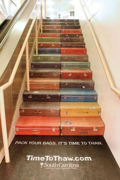 These vintage suitcases are painted onto steps.