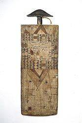 Talismanic Qur'an Board, Omdurman City, Sudan, c. 1922.  Memorized verses are erased with water, and new ones are written in their place, superimposing layers of verses. As these traces accrue, so does the potency of the board's active and available blessing.